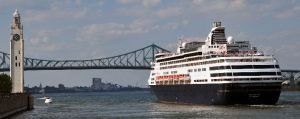 The Maasdam departing Montreal on a cruise. On the left is  the Sailors' Memorial clocktower on Victoria Pier. This is where the Canada Steamship Lines and Clarke Steamship Company cruise ships sailed from